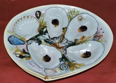 The number of depressions or the depth of the oyster-shaped wells in an oyster plate currently impact value and desirability with antique oyster plate ... & Oyster Plates | Dr. Lori Ph.D. Antiques Appraiser