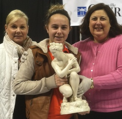 Dr. Lori holding with Belleek piece with mother and daughter