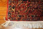 Antique rug on wood floor