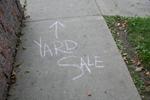 Yard sale written with chalk on sidewalk