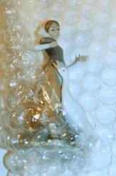 Antique figurine in bubble wrap