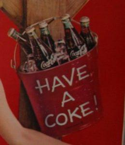 Coca Cola bottles in bucket