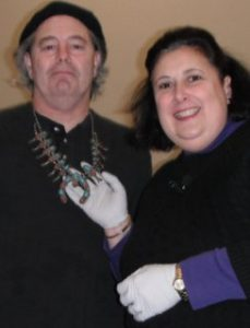 Dr. Lori with man wearing antique necklace