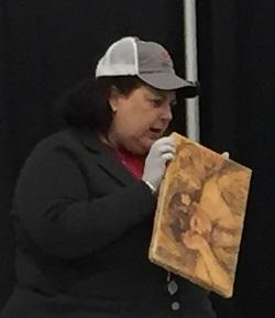 Dr. Lori holding a Renoir painting