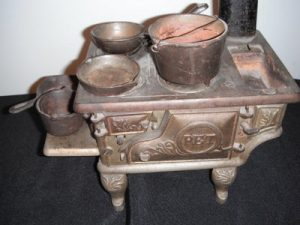 Antique kitchen stove with pots and pans